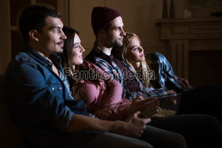 side view of friends watching movie