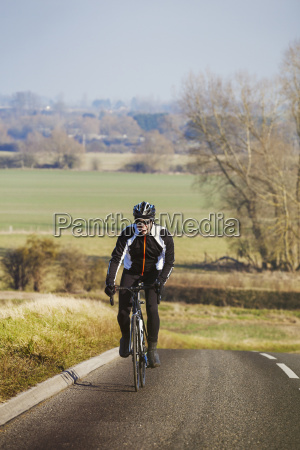 a man pedalling out of the