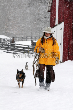 woman walking with her dog on