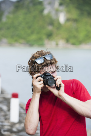 man taking picture with digital slr
