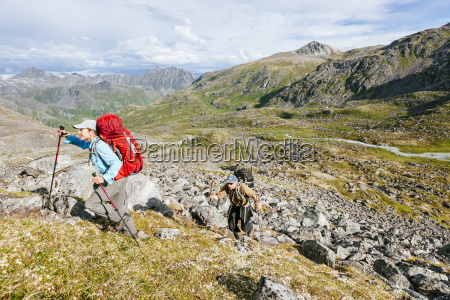 man and woman hiking up a