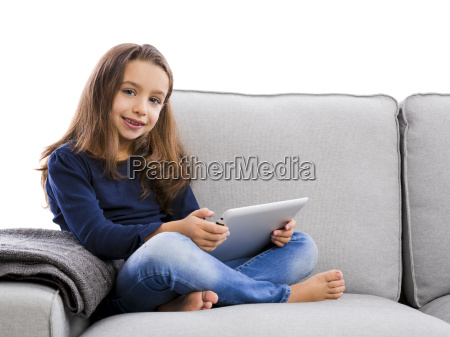 little girl working with a laptop