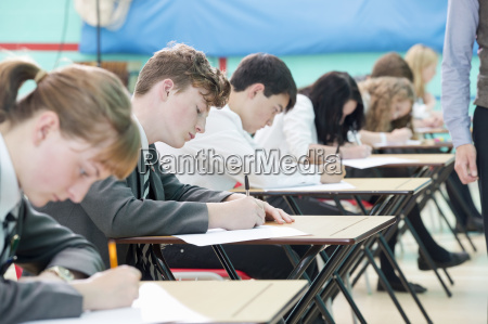 focused middle school students taking examination