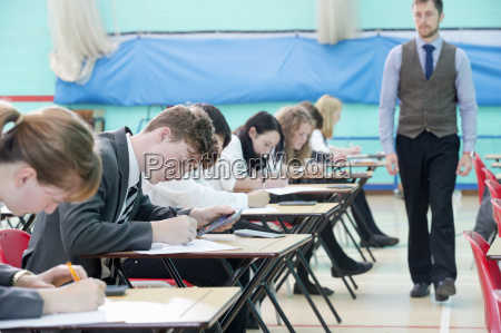 teacher supervising middle school students taking
