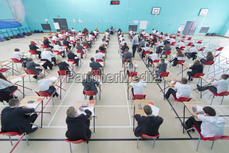 middle school students taking examination at