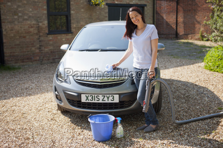portrait happy woman washing and vacuuming