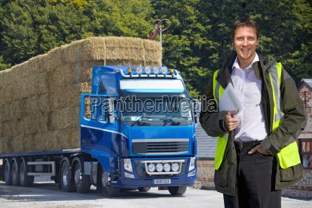 man standing by weighbridge as lorry