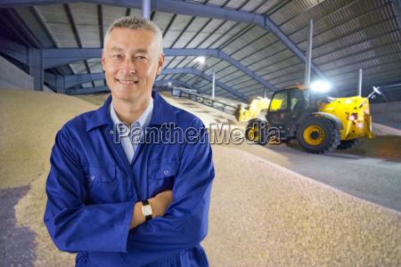 portrait of farmer inspecting wheat crop