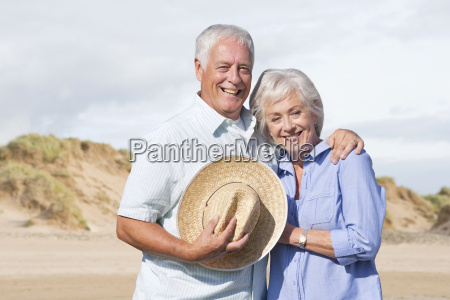 portrait of mature couple enjoying beach