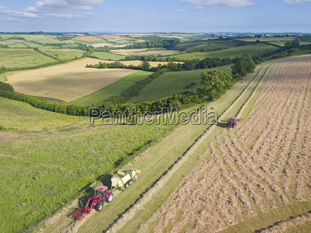 aerial view of tractor baling hay