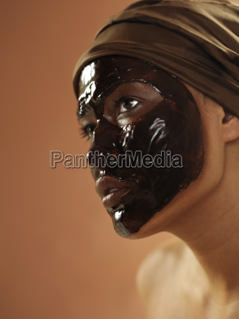woman with chocolate face mask