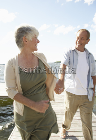 couple walking along dock