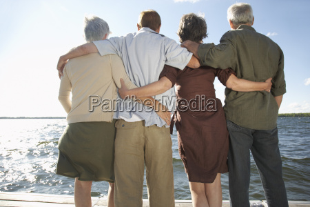 couples standing on dock