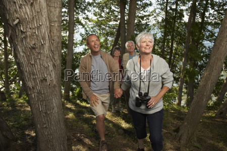 couples walking through woods