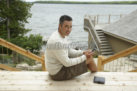 portrait of man at cottage