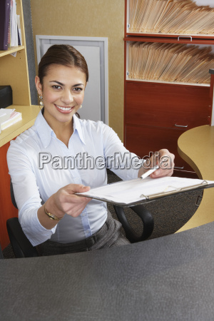 receptionist with clipboard