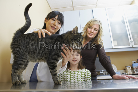 mother and daughter with cat at