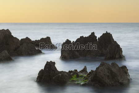 coastal rock formations at sunset in