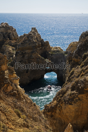 natural arch in rocks and ocean