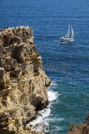 sailboat and cliffs at lagos algarve