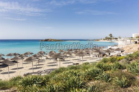 beach umbrellas on nissi beach at