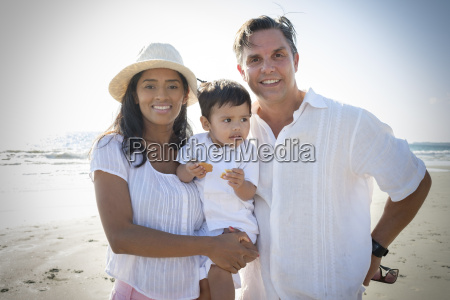 portrait of happy couple with little