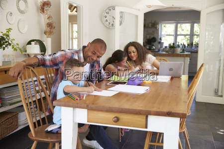 parents helping children with homework at