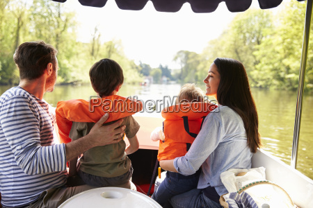 family enjoying day out in boat