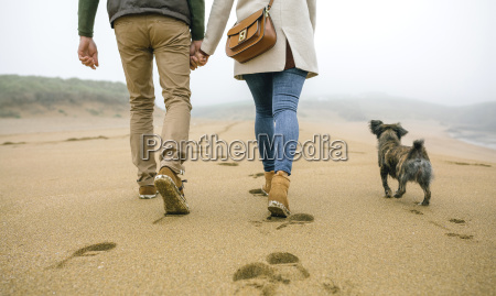 low section of couple walking on
