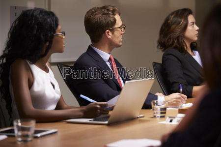 business colleagues listening at boardroom meeting
