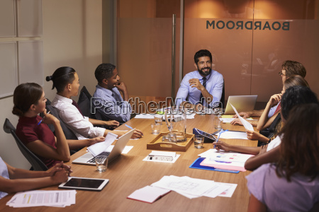business people listening to manager at