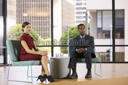 smartly dressed man and woman on
