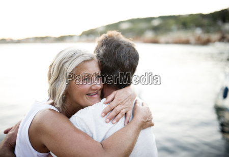 happy senior woman hugging her husband