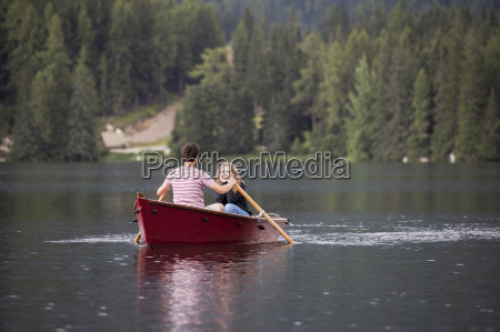 young couple in rowing boat on