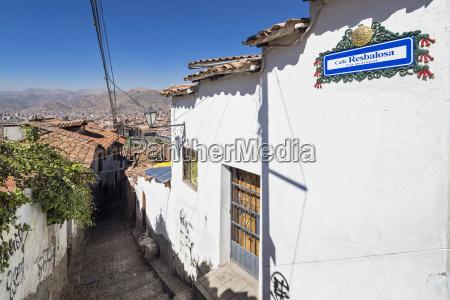peru cusco alley with cobblestones in