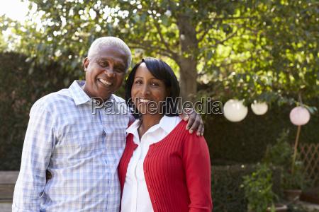 senior black couple in their garden
