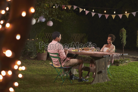 young black couple relaxing at dinner