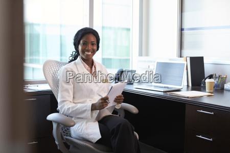 portrait of female doctor wearing white