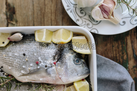 sea breams in baking dish with