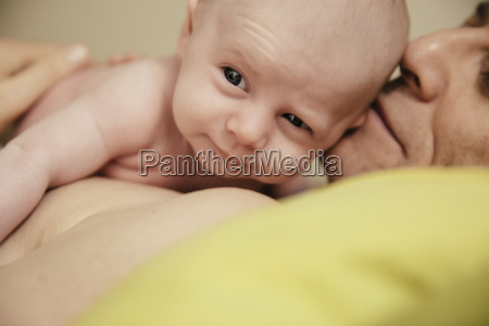 close up of father cuddling with