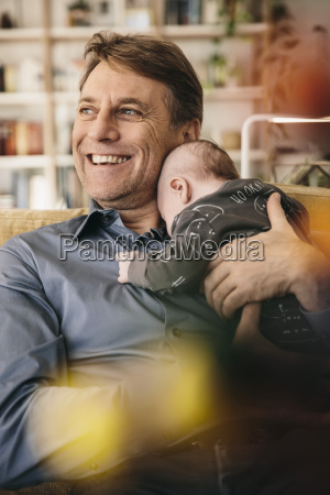 happy father and his newborn baby