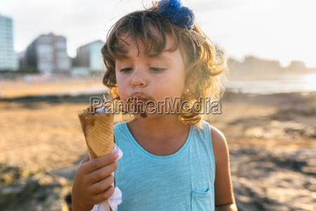portrait of little girl eating chocolate
