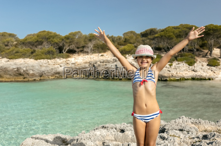 girl standing at the beach with
