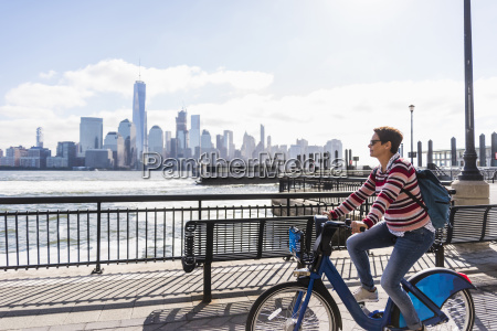 usa woman on bicycle at new