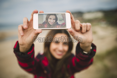photography of young woman taking a