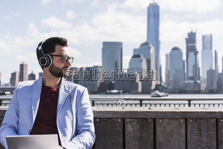usa man with headphones and tablet