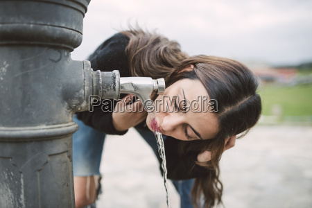 young woman drinking water from a