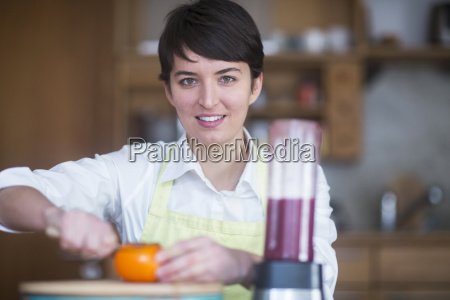 portrait of young woman preparing healthy