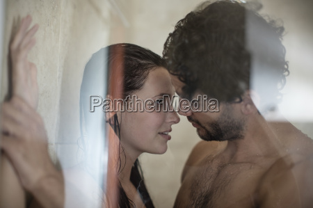 intimate young couple in shower