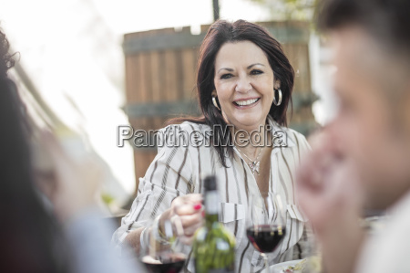 smiling senior woman at family lunch